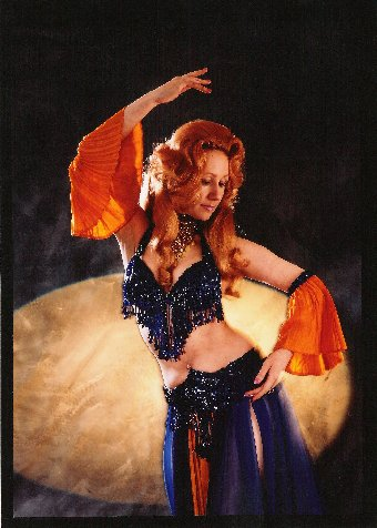 Jacqueline in purple/orange cabaret costume