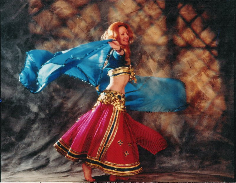 Jacqueline in a modern blue, red and gold